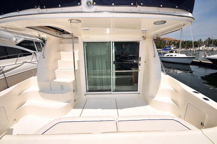 50 ft. Sea Ray – Luxury Power Yacht - Wide beam - reception under flybridge hard top courtesy cushioned stern seats