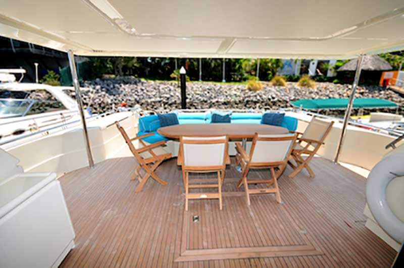 80-FT-Ferretti-Power-Yacht-Up-to-30-People-Boarding-Deck-with-Shade-Table-Seats